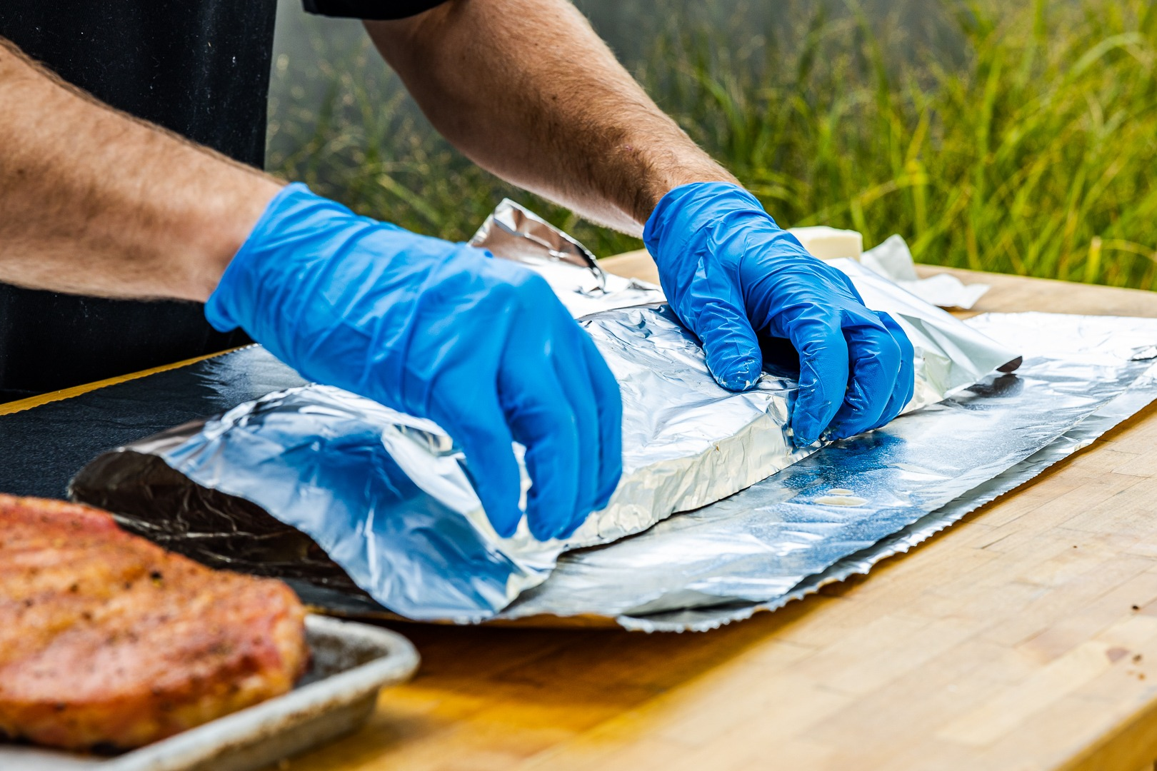 wrapping ribs in foil, doubling over the end bones
