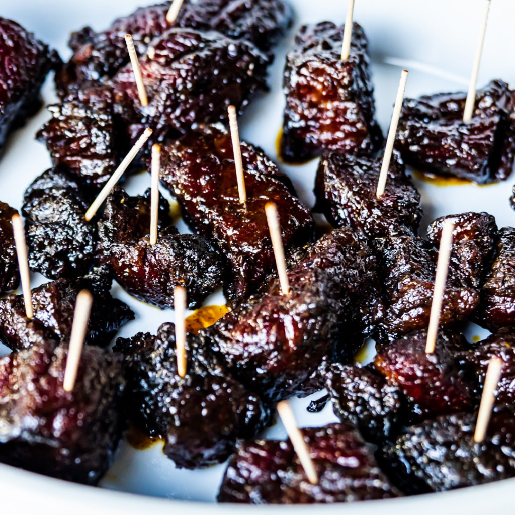 Brisket burnt ends with toothpicks in them