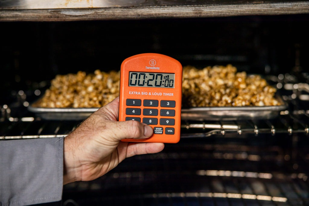 Setting a timer for 20 minutes to bake the popcorn