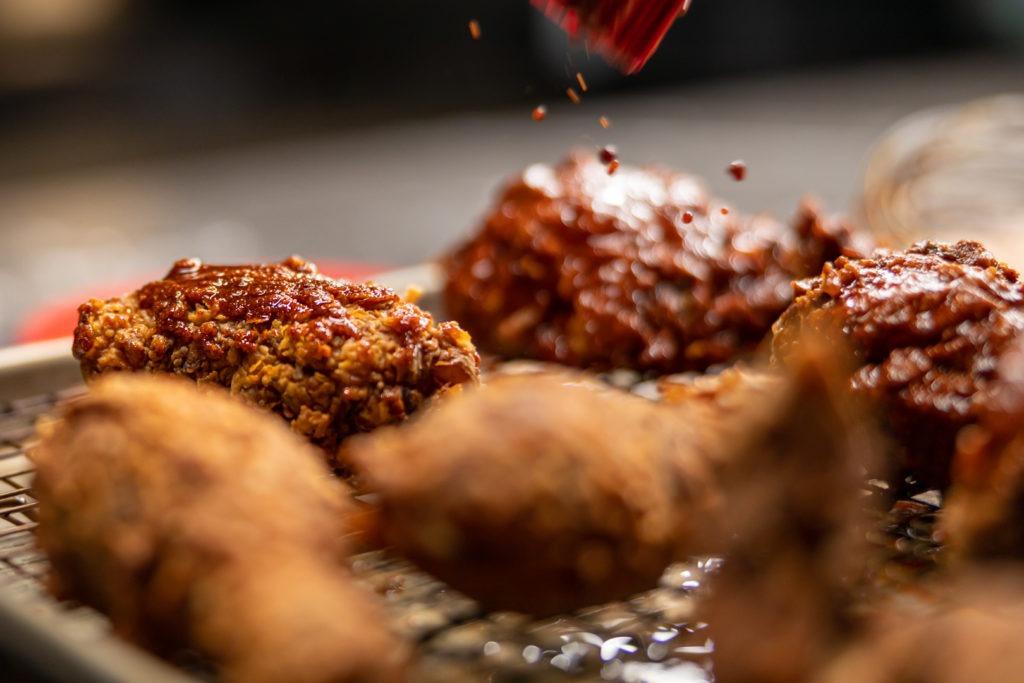 basting the Nashville hot chicken