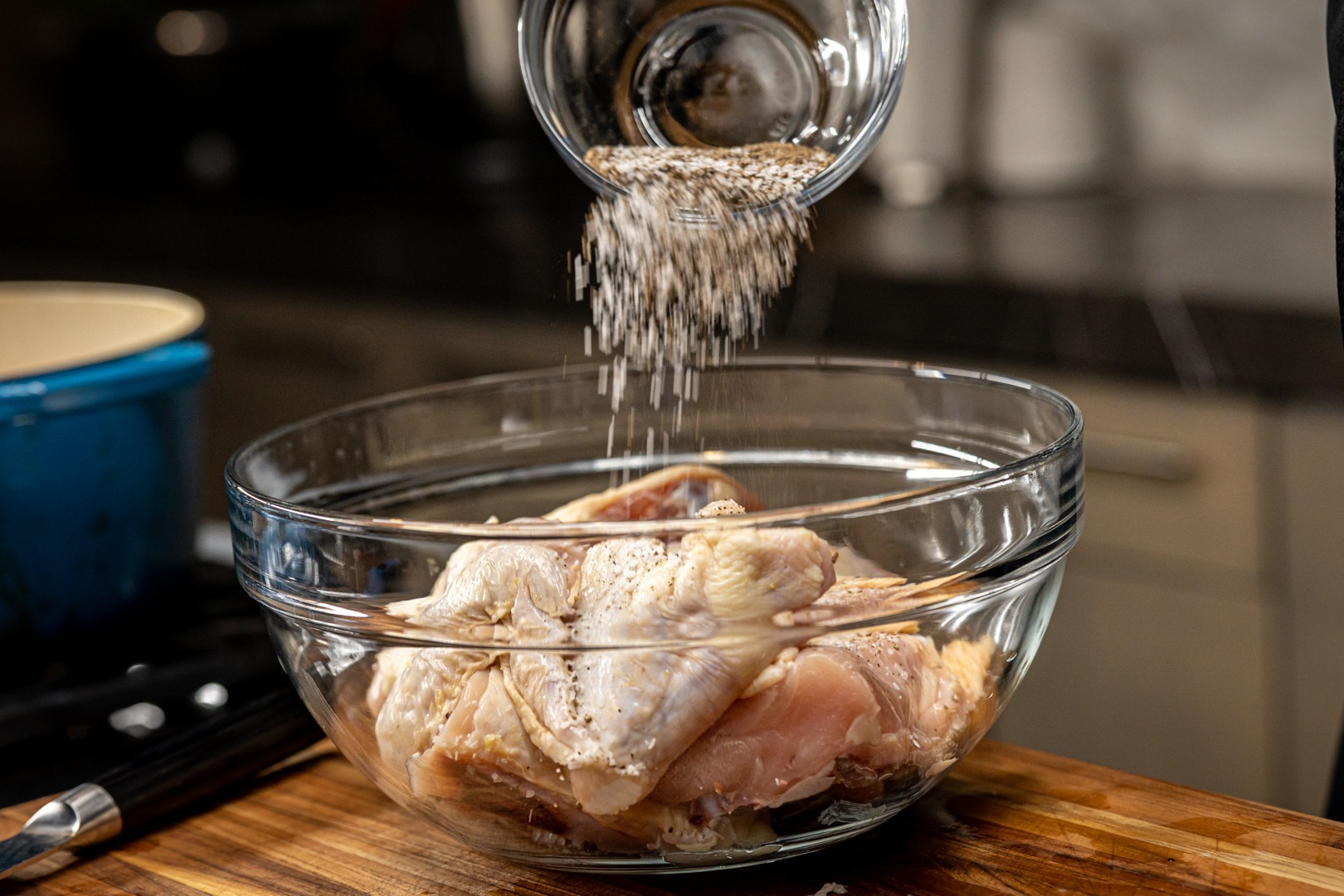 Salting and peppering the chicken