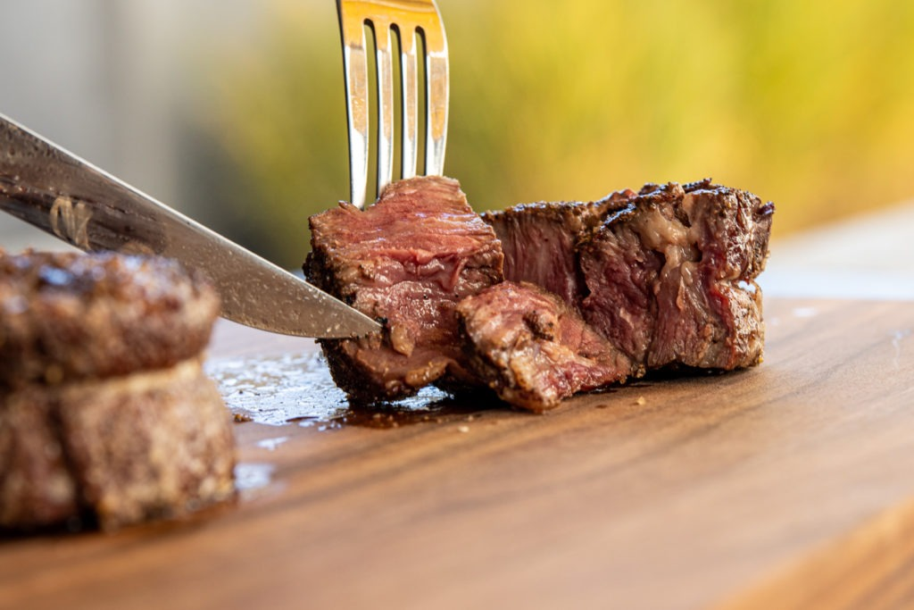 A perfectly cooked ribeye cap steak