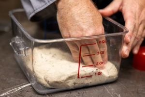 Pressing the dough into a square container