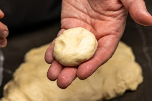 a small, flattened ball of dough