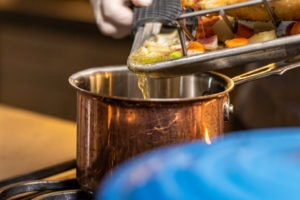 Pouring fat from the roasting pan