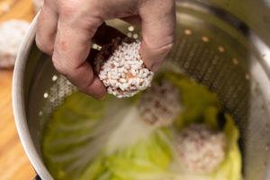 placing dumplings in the steamer basket