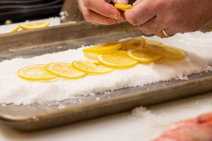 Lining the salt bed with lemon slices