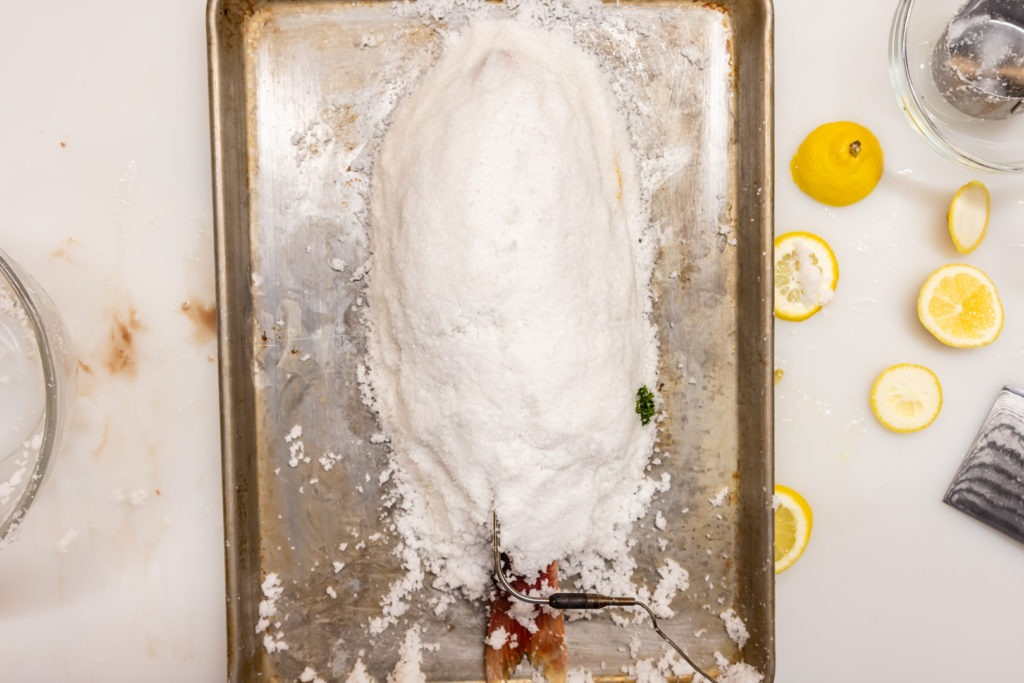 A salt-encrusted fish ready for baking