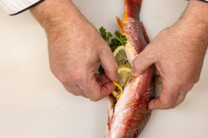 Stuffing the cavity of the fish