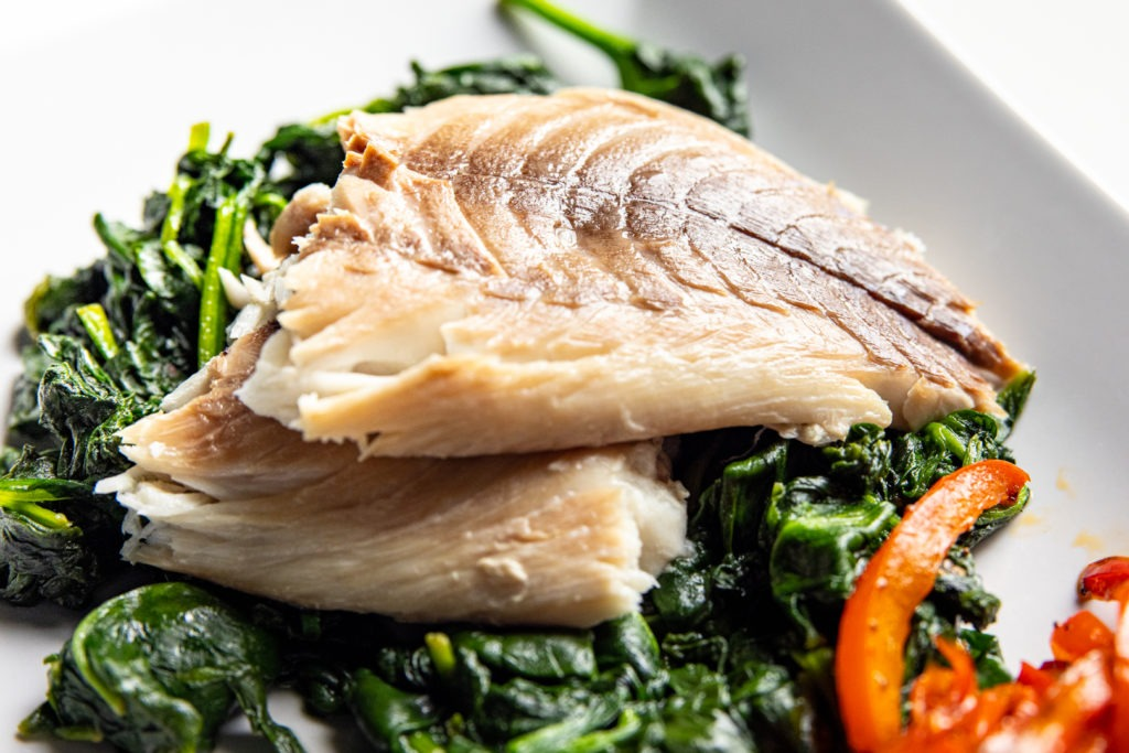 Snapper on spinach with peppers