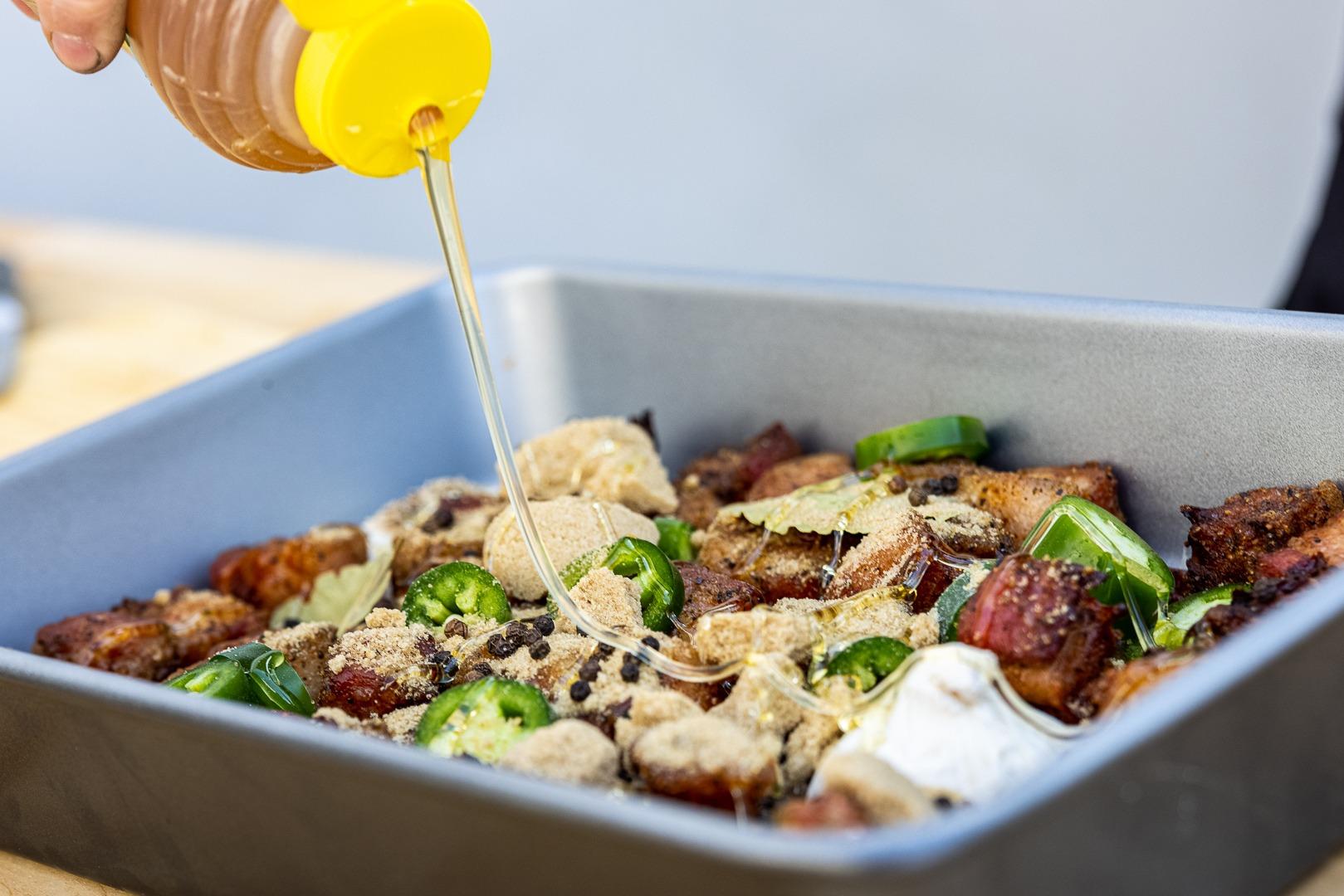 adding honey to the pan