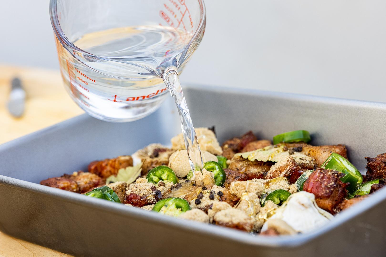 adding vinegar to the pan