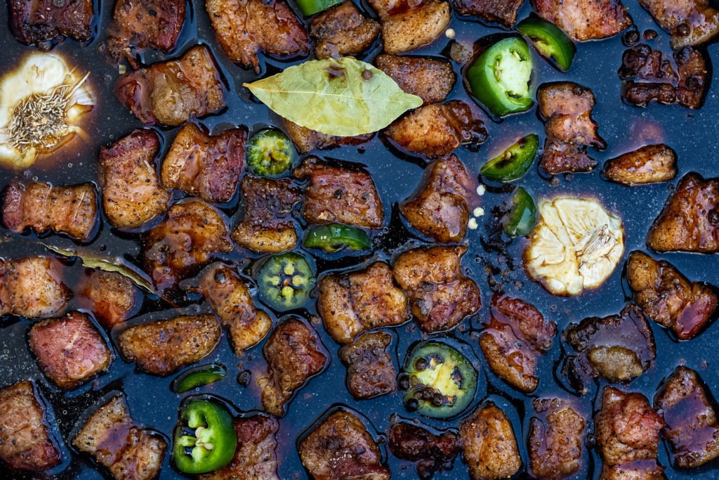 Pork belly cubes in adobo liquid