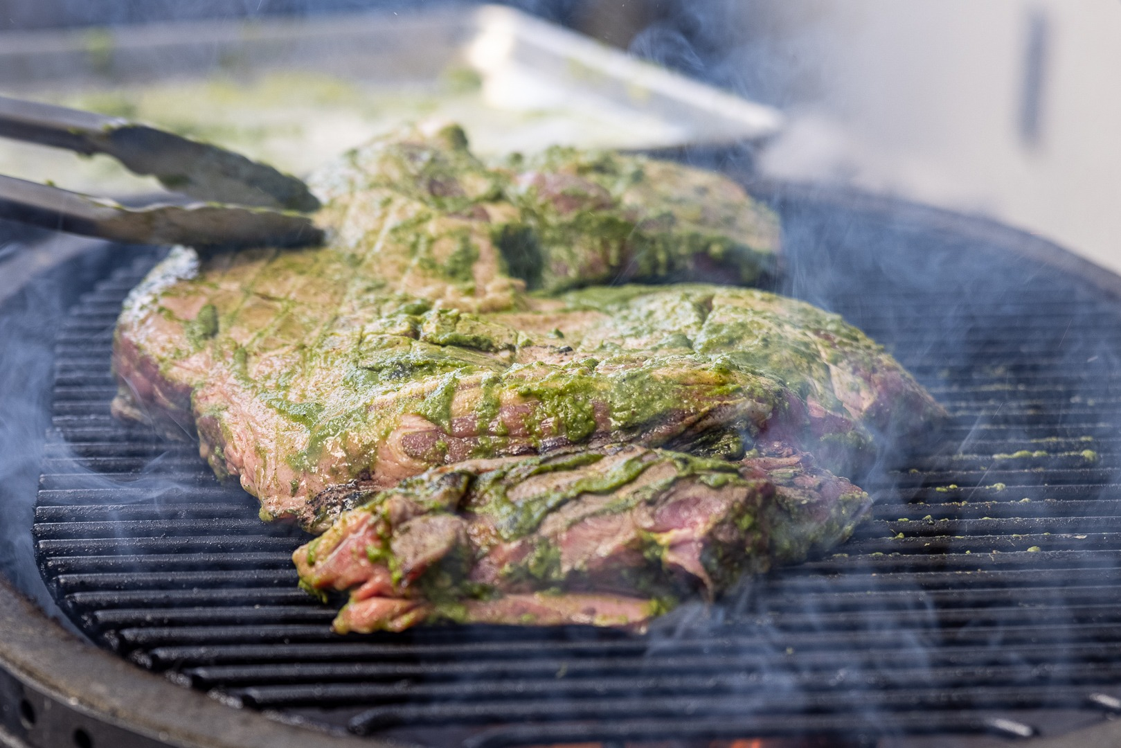the leg of lamb on the grill