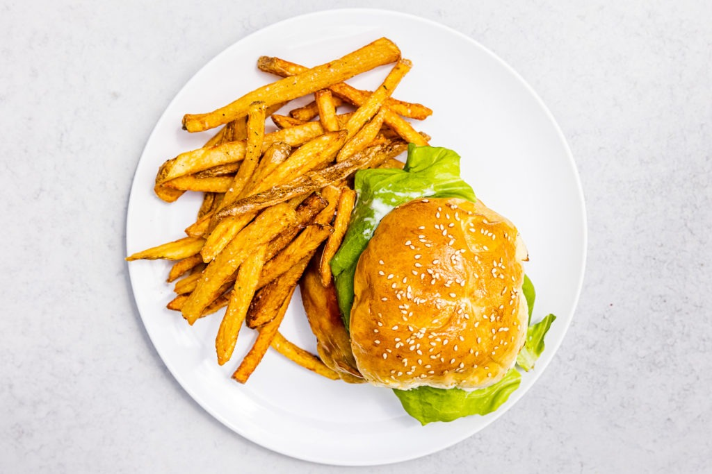 Delicious burger on a homemade bun with a side of fries