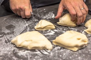 Cutting the buns from the dough ball