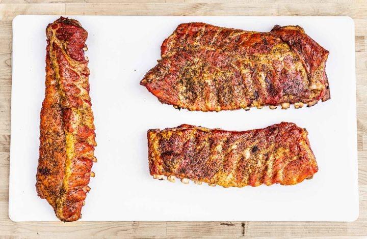 Three racks of cooked pork ribs