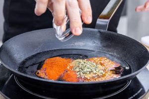 toasting the spices in oil