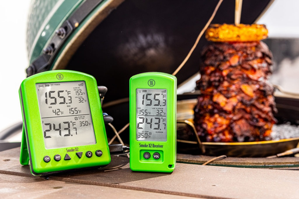 Pork al pastor, cooked on a spit, with thermometer in foreground