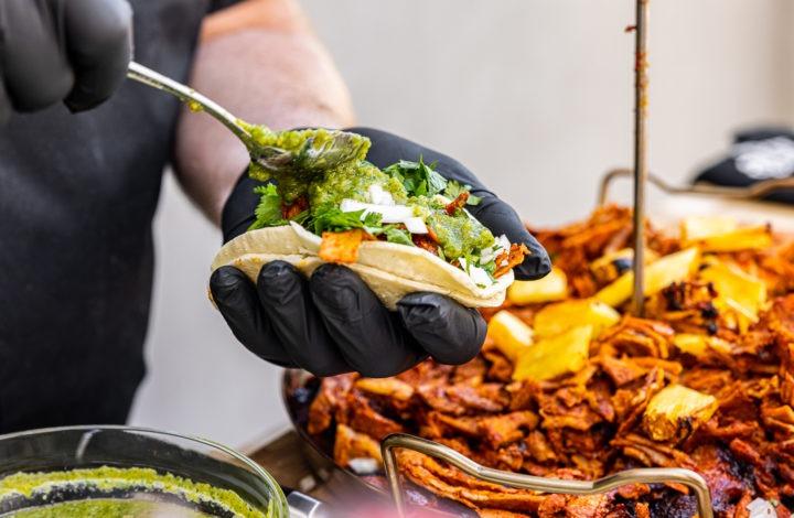 Assembling a taco al pastor