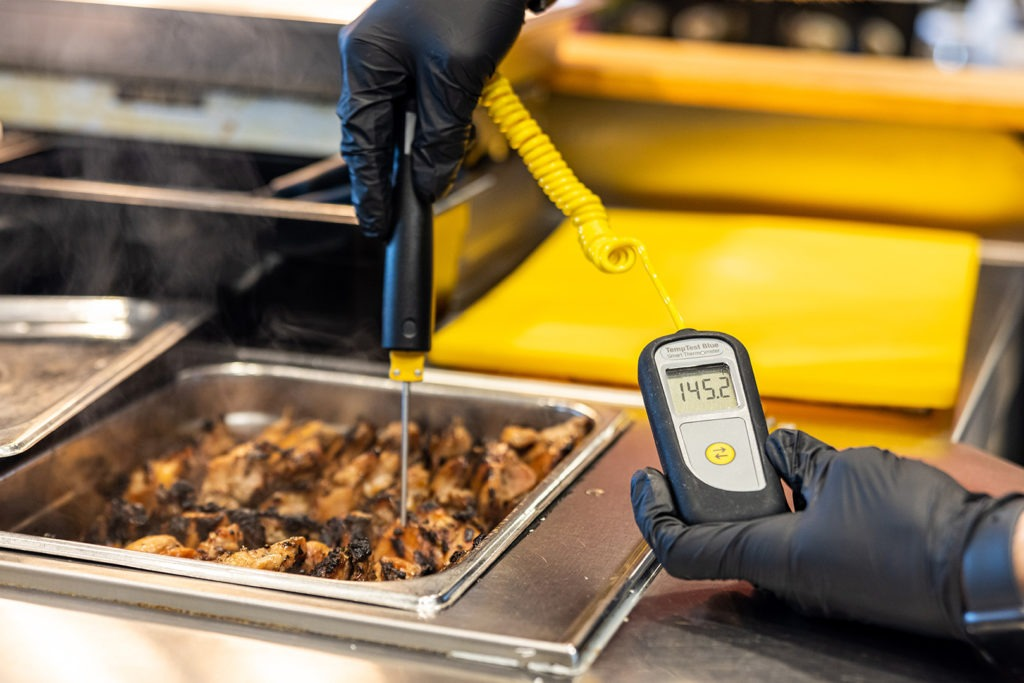 Temping a tray of hot food with a Bluetooth thermometer