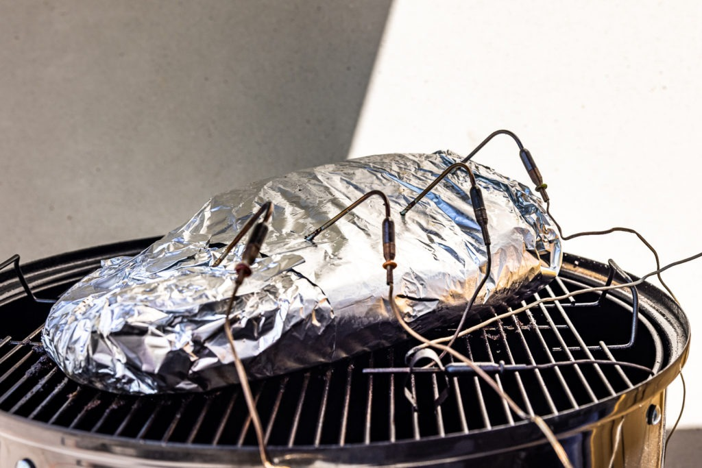 Foil wrapped brisket on the smoker