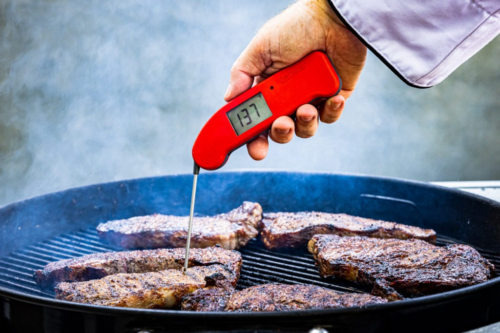 A Thermapen ONE temping a steak