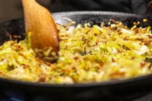 cooking the leeks in the bacon fat