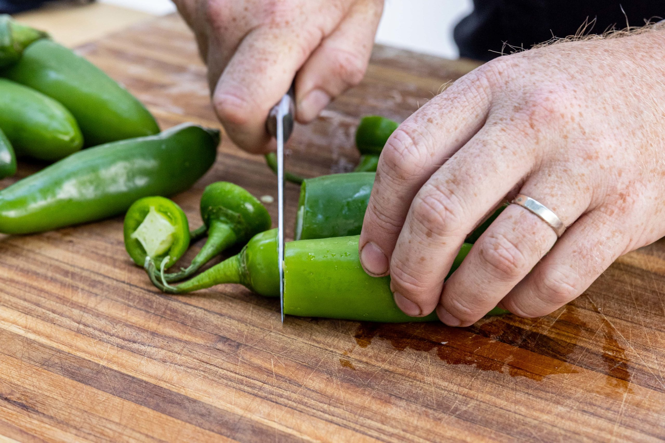 Cutting the tops from the peppers