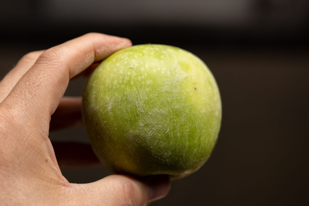 A sanded green apple