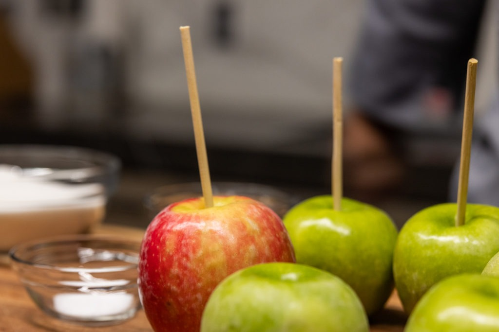 Apples with sticks in them for dipping in caramel