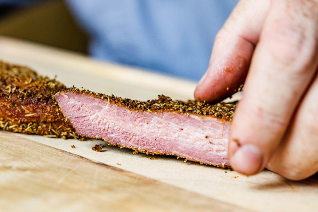 Slicing fresh tasso ham