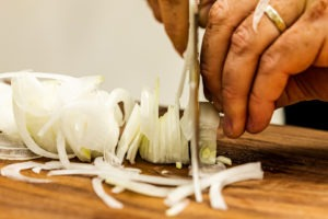 Slicing an onion thinly