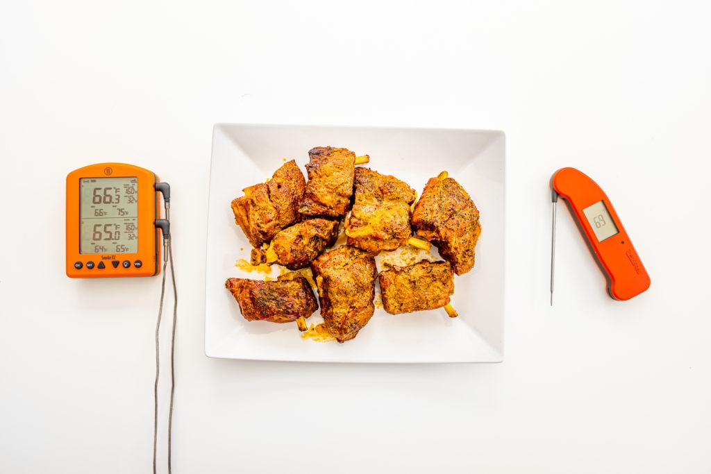 Pig wings/pork wings alongside thermometers for cooking