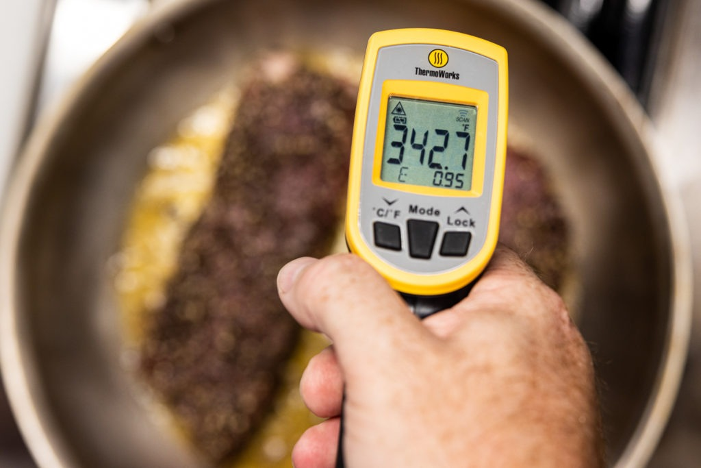 Temping the oil in the steak pan