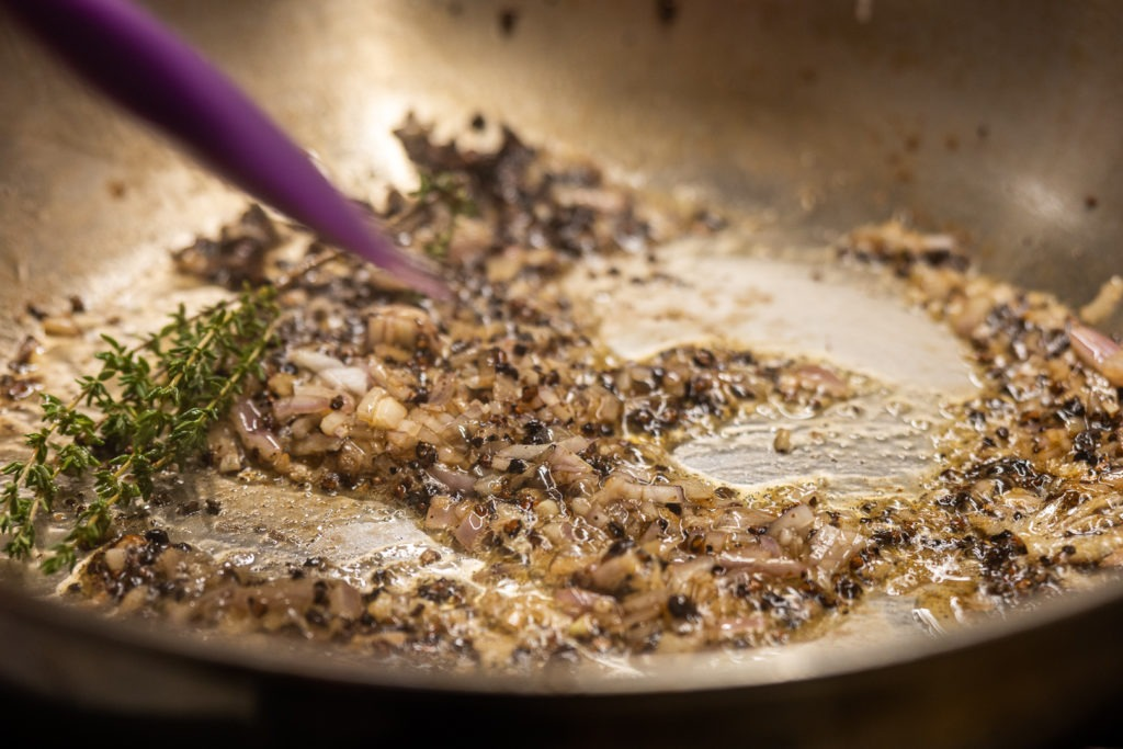 SHallots and thyme cooking in the butter
