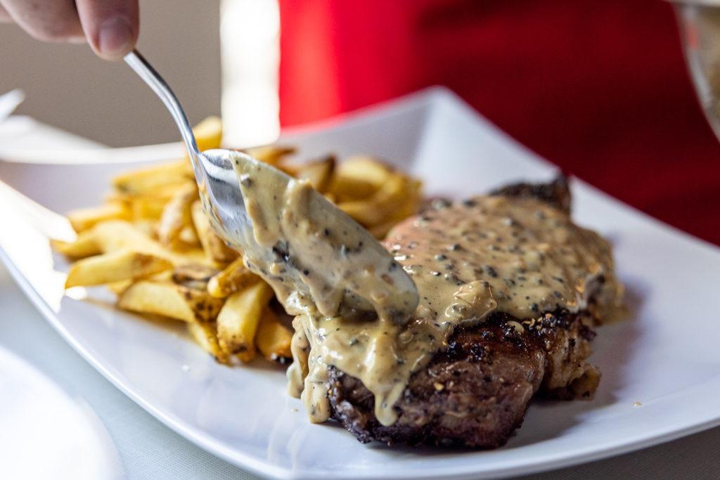 saucing the steak