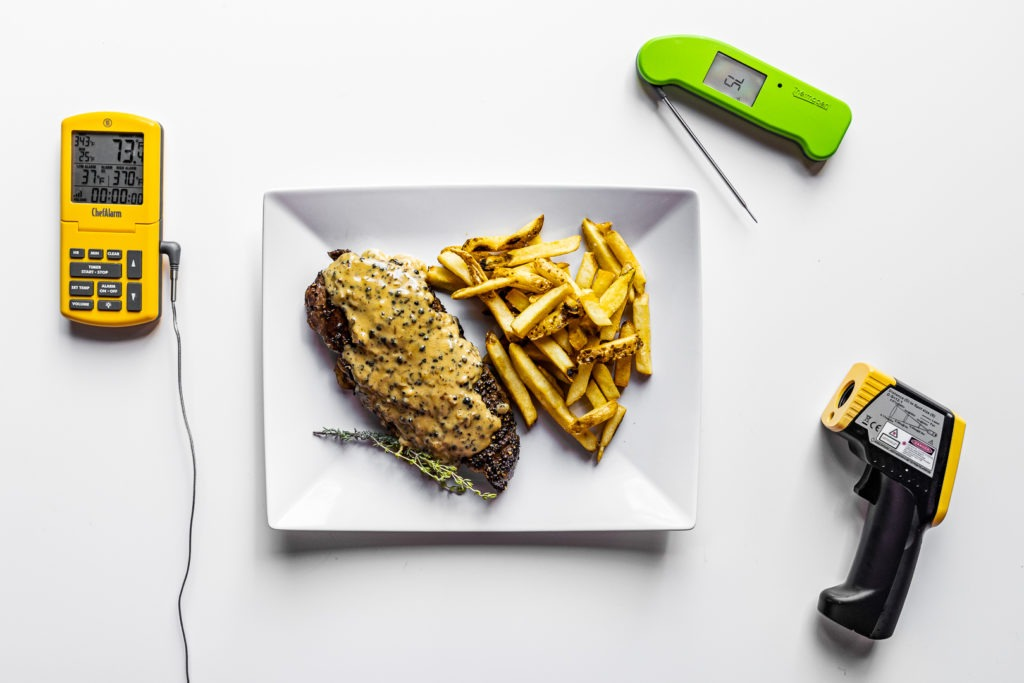 steak au poivre with frites and thermometers