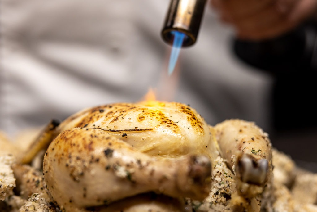 Toasting the skin of the hens