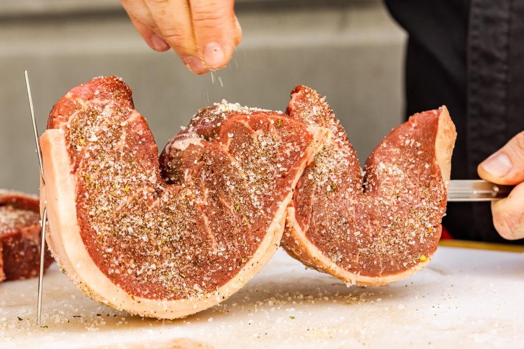 Seasoning picanha steaks