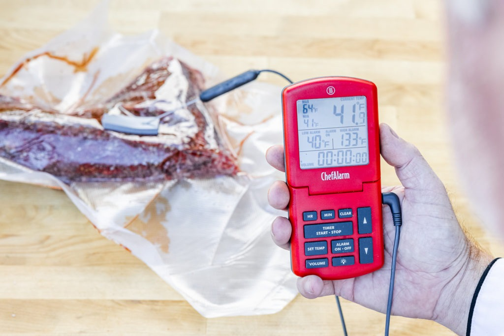 Setting the alarm on the thermometer for sous vide tri-tip